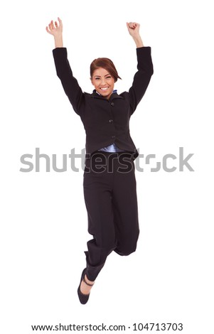 Jumping business woman. Celebrating successful businesswoman in suit jumping joyful isolated on white background in full length