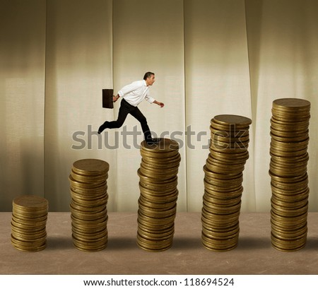 Jumping businessman in a stack of money - stock photo