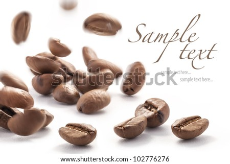 Jumping coffee beans, isolated on white background (with sample text)
