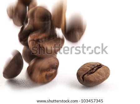 Jumping coffee beans, selective focus, isolated on white background - stock photo