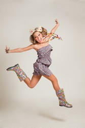 Jumping crazy girl, studio isolated shot