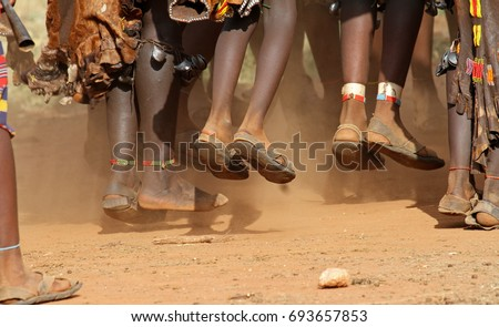Jumping feet from Hamar ladies on a bull-jumping-ceremony - Omo valley - Ethiopia