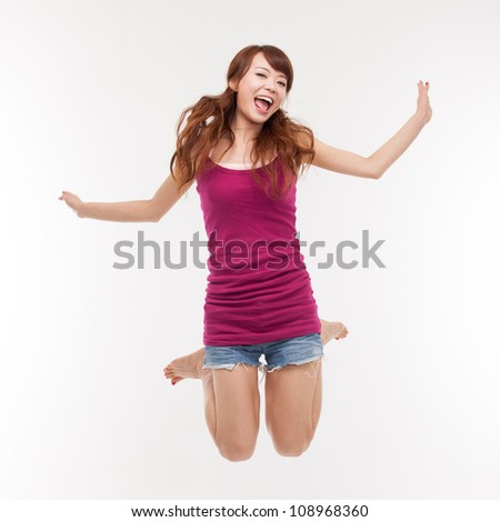 Jumping happy asian woman isolated on white background.