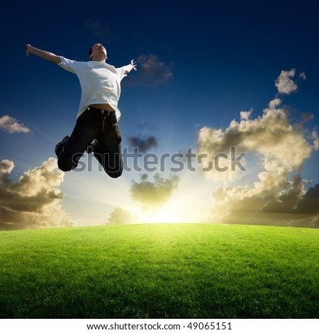 jumping happy young man - stock photo