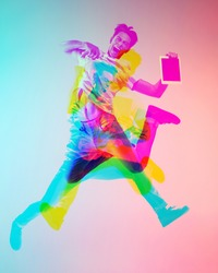 Jumping high. Multiple portrait with glitch duotone effect. Multiple exposure, abstract fashionable beauty photo. Young beautiful male model posing. Youth culture, composite image, fashionable people.