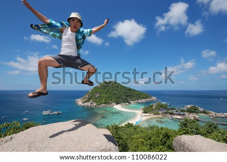 Jumping male traveler with landscape background.