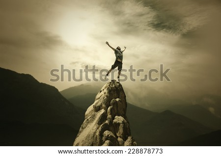 Jumping Man on the Peak #228878773