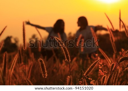 Jumping of young couple. Silhouette Scene