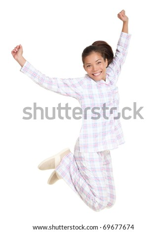 Jumping pajamas woman morning fresh and cheerful. Isolated on white background in full body. Mixed race Asian / Caucasian female model.
