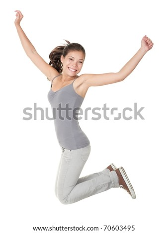 Jumping people isolated on white background: casual woman jumping happy and free in full body. Beautiful Caucasian Asian model smiling.