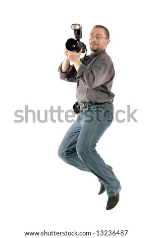 Jumping photographer with cam isolated over white background