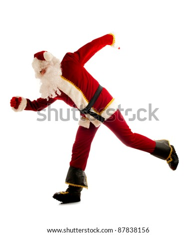 Jumping Santa isolated over white