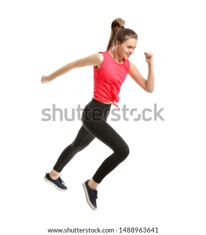 Jumping sporty woman on white background