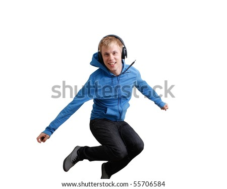 Jumping teenager listening to music - stock photo
