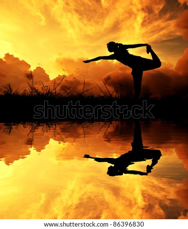 Jumping woman and sunset silhouette,water reflect