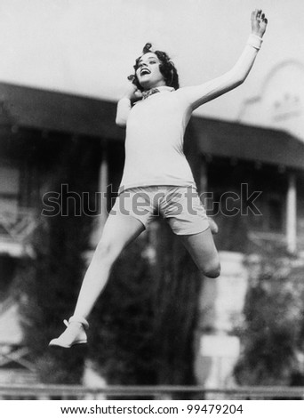 Jumping woman in midair