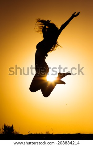 Jumping woman on the beach