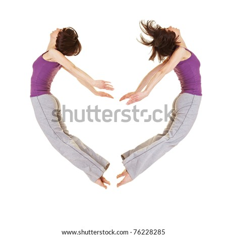 Jumping young woman forming a heart shape