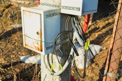 Junction box for connecting electrical wires. Attached to the lamppost