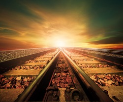 junction of railways track in trains station against beautiful light of sun set sky use for land transport and logistic industry background ,backdrop,copy space theme