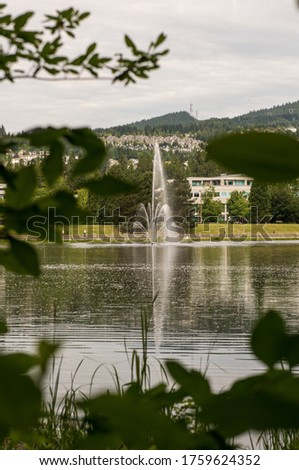 June 19,2020 Coquitlam British Columbia Canada Beautiful fountain spraying at Lafarge Lake stock photo