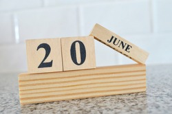 June 20, Cover design with number cube on a white background and granite table.