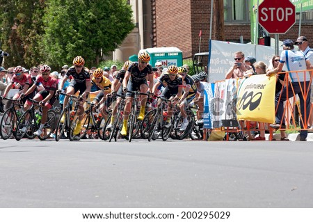 JUNE 15, 2014: Cyclists race for lead at final stage of 2014 North Star Grand Prix in Stillwater, Minnesota. About 300 top pro cyclists from around the world compete in the prestigious event.