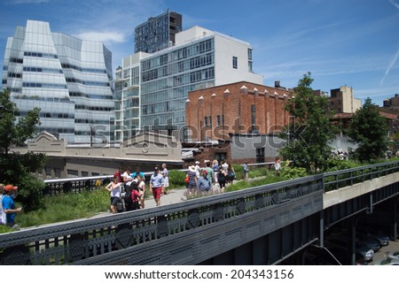 June 20, 2014 - New York, USA: Visitors walk on a path on the High Line. The High Line Park in New York City was created atop an abandoned elevated freight rail line.
