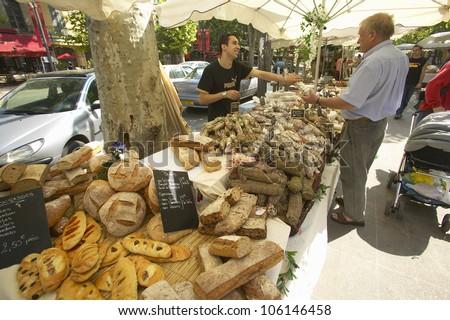 JUNE 2004 - Outdoor market, bread seller in Aix en Provence, France