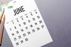 June 2020 simple calendar with office supplies and copy space