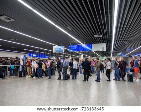 June 18, 2017. Wide angle view of travelers standing in long lines at the border control of Frankfurt International Airport, Germany. Travel and security editorial concept.