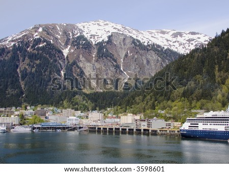Juneau, Alaska nestled at the base of tall, snow-covered mountains