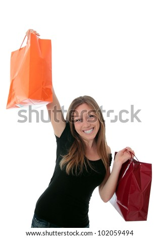Jung woman with 2 colorful shopping bags in the air