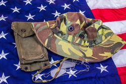 Jungl Hat, Dog Tags & Ammo Pouch On American Flag