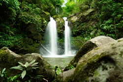 Jungle double waterfall cascade in tropical rainforest with rock, Sapan Waterfall beautiful waterfall of NAN province in north thailand