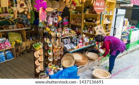 Jungnogwon-ro, Damyang-eup, Damyang-gun, Jeollanam-do/South Korea- 05 06 2019: Damyang Bamboo Forest Festival (Juknokwon)- shops selling artifacts and food  #1437136691