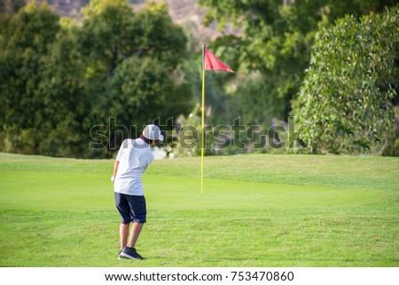 junior golfer - chipping #753470860