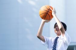 Junior high school student playing basketball