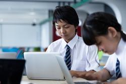 Junior high school students doing group work