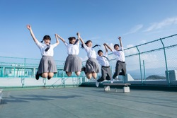 Junior high school students jumping on the roof