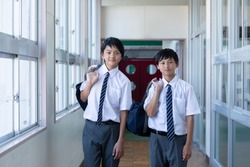 Junior high school students standing side by side in the corridor