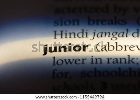 junior word in a dictionary. junior concept. #1155449794