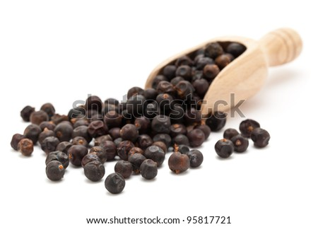 Juniper Berries in wooden scoop on white background