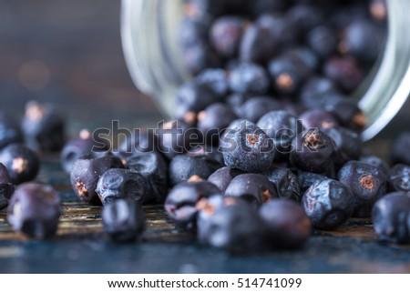 Juniper Berries Spilled from a Spice Jar #514741099