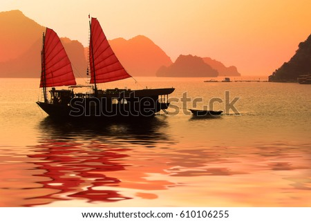 Junk boat at sunset in Halong Bay, Vietnam #610106255