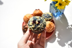 Junk food, delicious sweet muffin, tasty cup cake, white background, confectionery, bakery, homemade, blue berry muffin with butter chips and blue berry jam, sugary treats