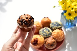 Junk food, delicious sweet muffin, tasty cup cake, white background, confectionery, bakery, homemade, sugary treats, chocolate muffin