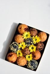Junk food, delicious sweet muffin, tasty cup cake, white background, confectionery, bakery, homemade, sugary treats, muffins box with yellow daisy, blue berry muffin, chocolate chips