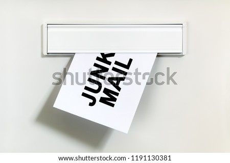 Junk mail or spam on letter being delivered through a letterbox concept for unsolicited mail or e-mail Stock photo ©