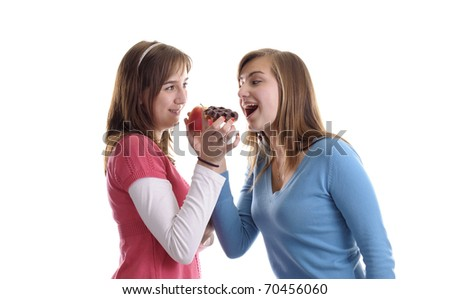 junk vs healthy food. Two young woman with apple and waffle